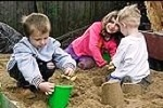 chidren playing in public sandbox