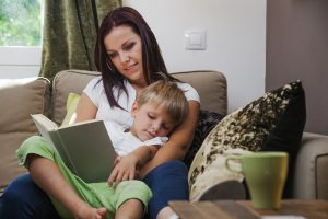 mother reading to child before bed