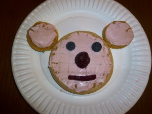 bear face craft made from different size waffles, cream cheese and pieces of fruit