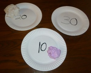 crunch and toss is a game played with paper plates, and colored paper