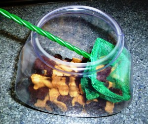 fish bowl with fish shaped cookies in it