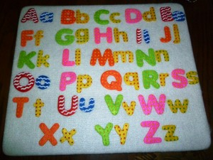 An alphabet board helps the kids think of their letters