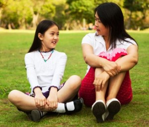 mom-talking-to-tween-daughter-in-park